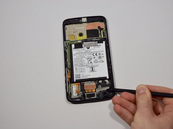 Use the nylon spudger to lift and remove the speaker from the phone chassis.