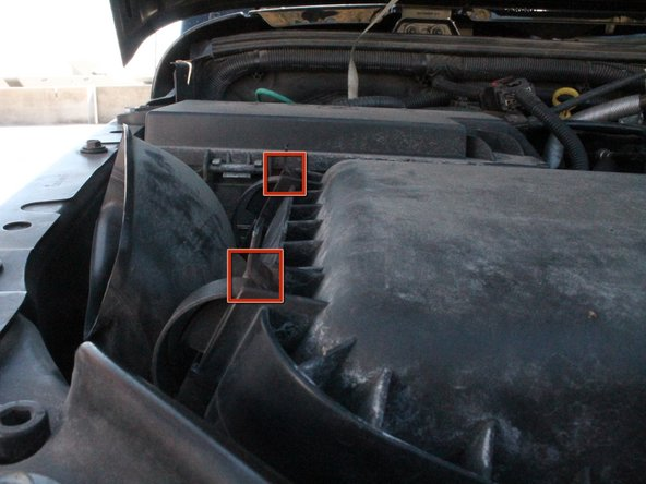 Locate the four clips keeping the air filter box sealed.  Their locations are as follows: