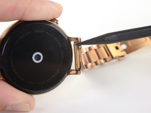 Use your finger or the tip of a spudger to compress the pin securing the watch band.