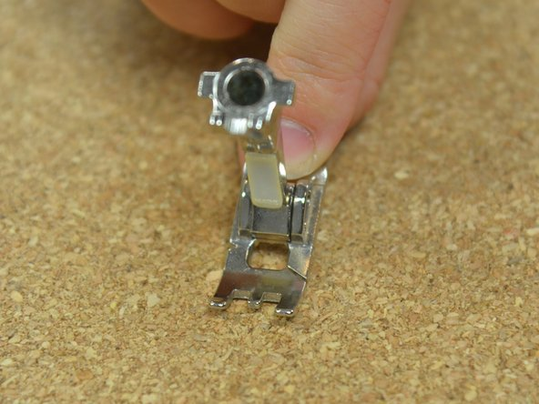 Grab your desired presser foot, and orient it foot-down.