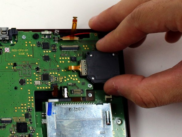Lift the circle pad casing upward to remove it. There will be some friction, but it should not require excessive force.