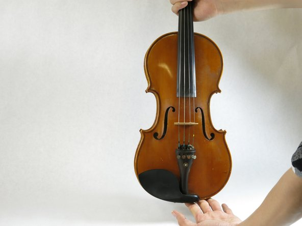Identify two sides of your violin.  The violin bridge has one side that is higher than the other. The lower side is the E-string side.