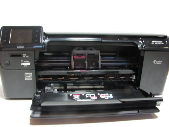In order to remove the old cartridge, open the mouth of the printer by pulling down on it.