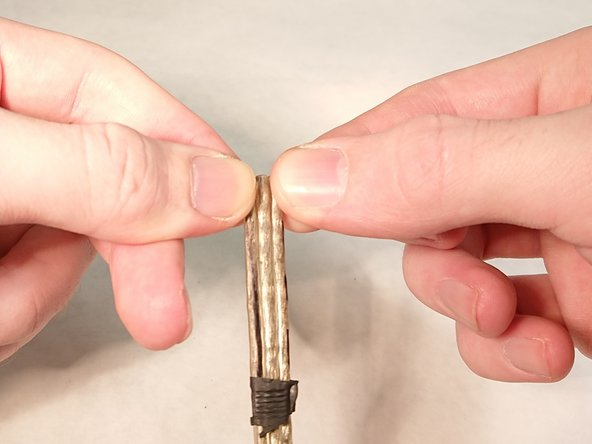 """Peel the wires of the cord apart about 1"""" (2cm)."""