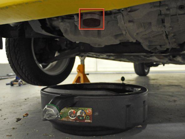 Wipe off and replace the oil pan drain plug. Use a moderate amount of force, but do not over-tighten the bolt.