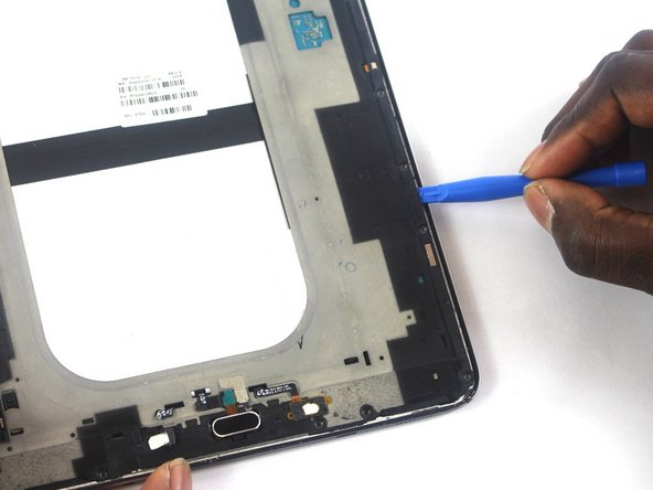 Take the plastic opening tool around the tablet to remove the motherboard from the device.