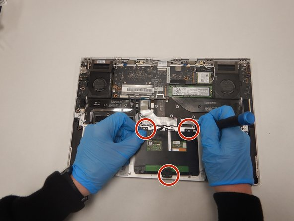 Remove all 6 screws attached to the trackpad with a small Phillips head screwdriver.