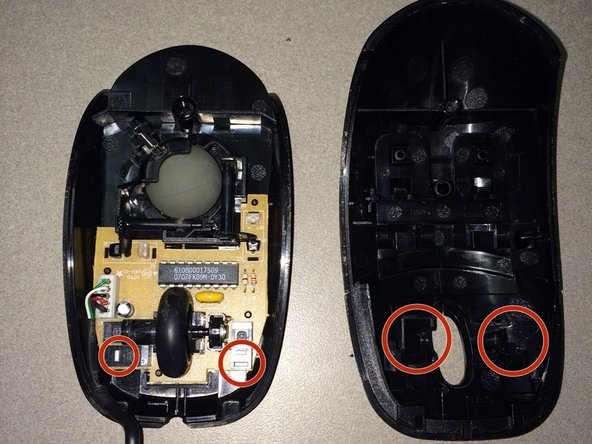 Take off the top of the mouse.