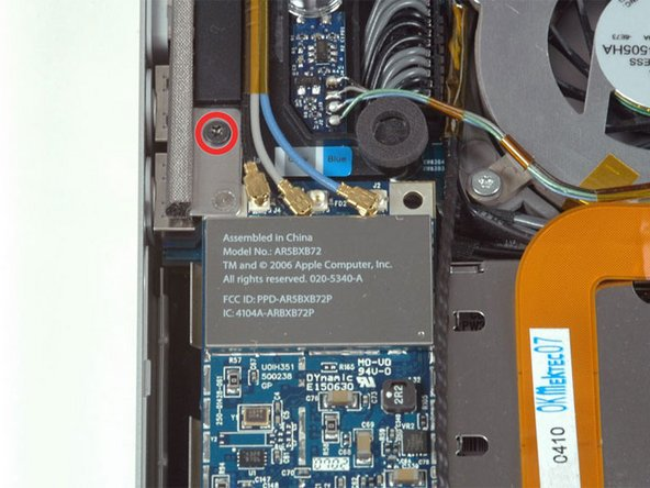 Remove the single black T6 Torx screw located just above the Airport Extreme card.