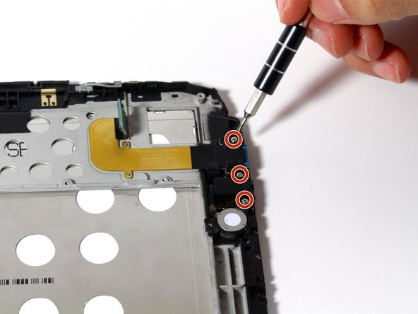 Remove the three 2mm screws along the right side of the device using a PH00 screwdriver.