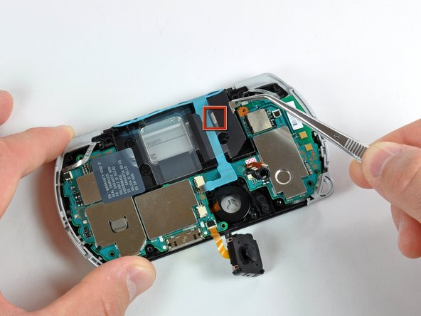 Use a pair of tweezers to pull out the battery's clear plastic cover.