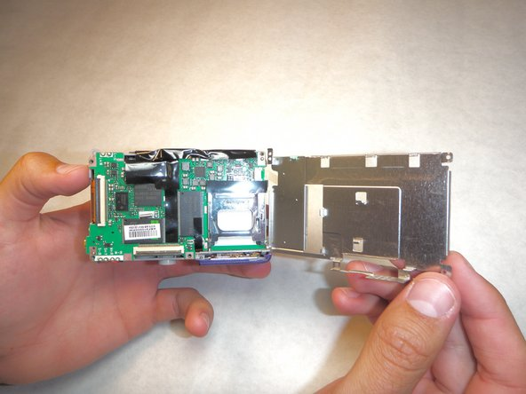 Be careful when rotating the plate in the next step to prevent the ribbon cable in the top right from ripping.