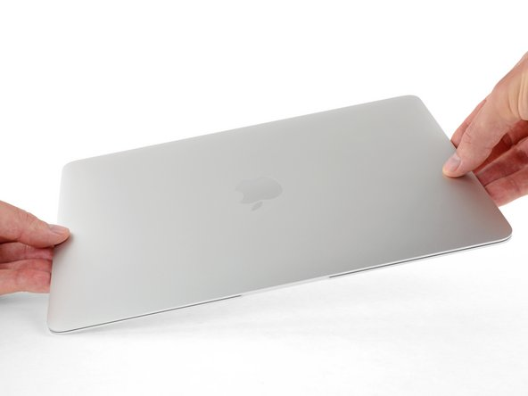 Carefully close the MacBook and flip it over once again, so that the Apple logo faces up.