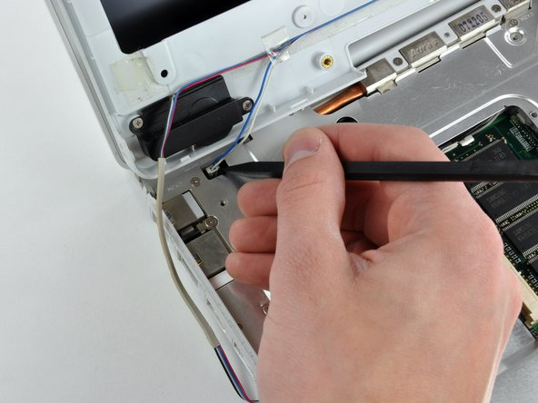 Using the sharp end of a spudger, disconnect the connector for the blue and white power cables.  Again, be careful to pry up only on the connector.