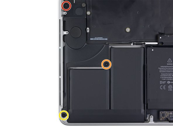 Remove the following screws securing the right speaker to the upper case: