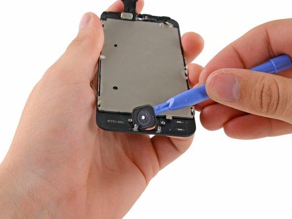 用塑料开机工具撬开 Home键。
