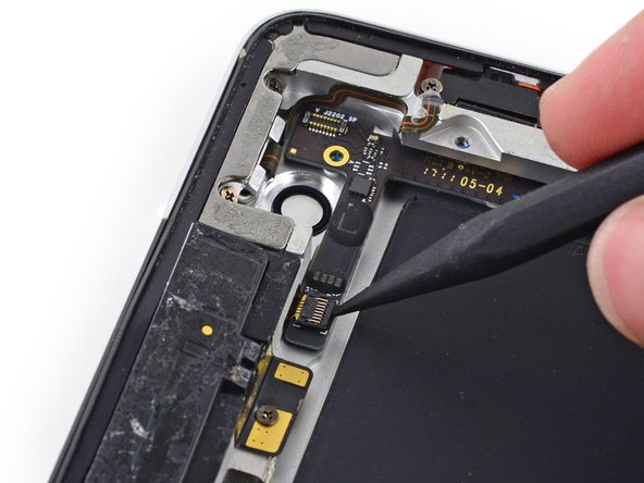 Remove any foam tape from the top of the GPS cable ZIF connector.