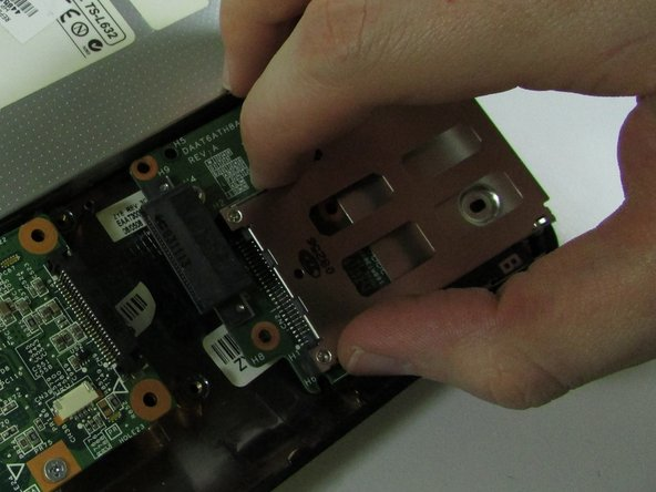Remove ExpressCard component by sliding it out.