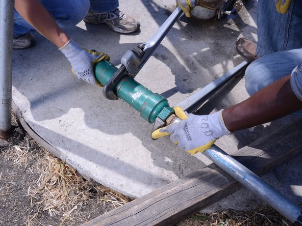 Using two pipe wrenches, unscrew the cylinder from the riser main.