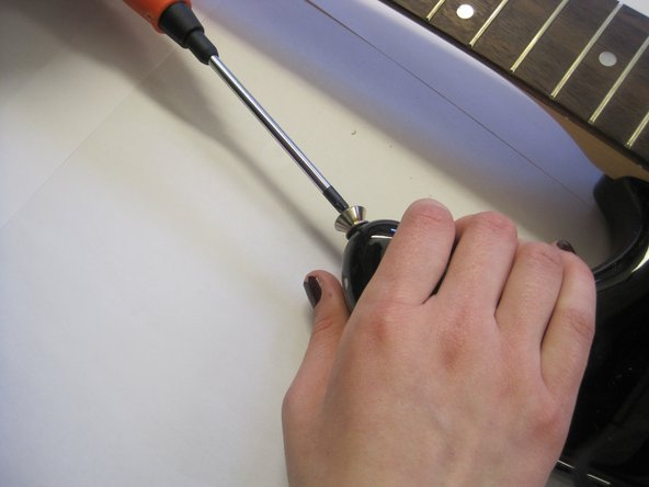 Carry out the same process to remove the top strap button.