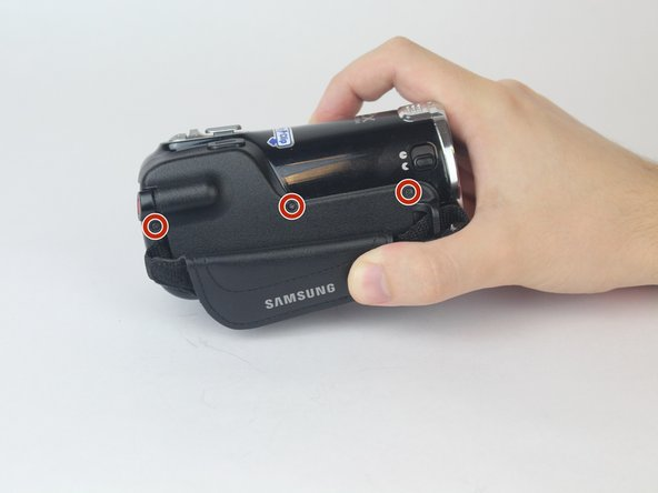 Rotate the camcorder so that the strap side is facing you.