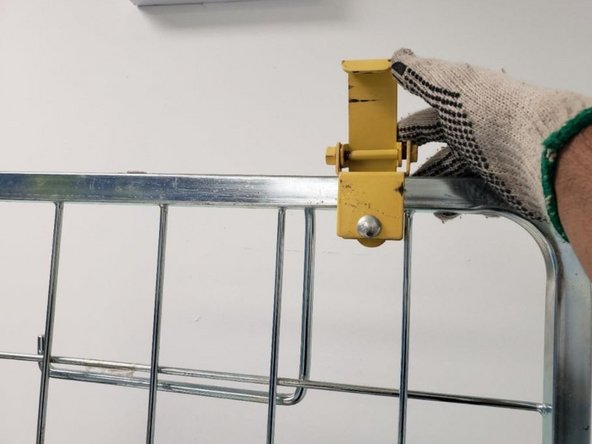 Pull down the safety latch to make sure the rocket cart is in secure position.