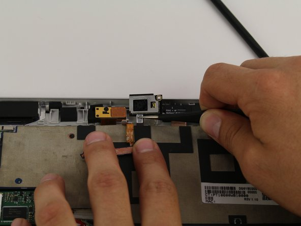 Use a pair of tweezers to disconnect the flex cable from the motherboard and remove the rear facing camera from the device.