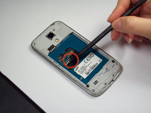 Remove Sim Card using a tweezer or fingers