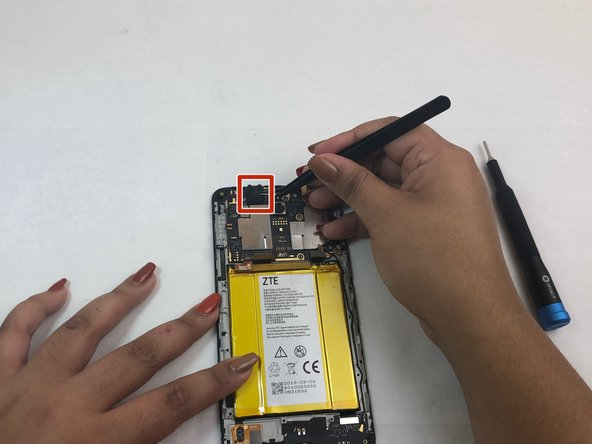 Use tweezers to remove the protective foam surrounding the headphone jack at the top left of the device.
