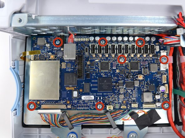 Remove the eight Phillips #1 screws from the motherboard.
