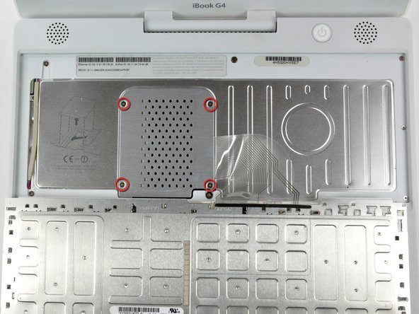 Remove the four silver Phillips screws that secure the RAM shield.