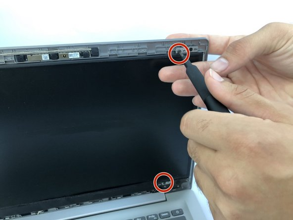 Remove four Phillips #0 screws from the corners of the LCD screen to detach the screen from the mounts.