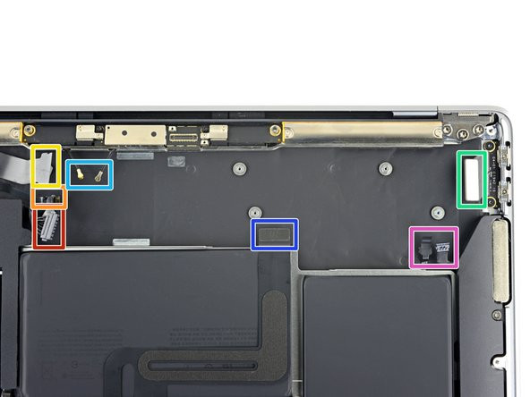 When you reinstall the logic board assembly, verify that no cables get trapped under the board as you lower it into place. Check each of the seven locations carefully:
