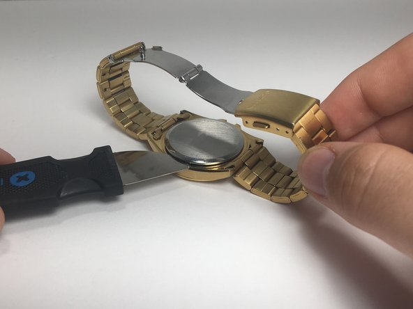 Locate the notch under the back cap of the watch. Wedge the jimmy into the notch, and pry off the back.