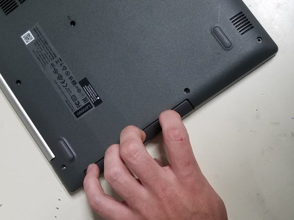 Carefully slide out the DVD Drive