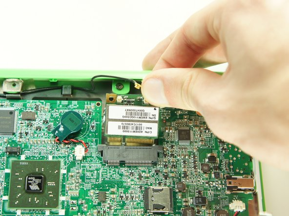Remove the wireless card by gently lifting it out of the socket.