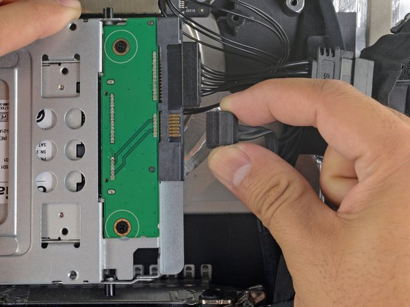 Connect the iMac's SATA data cable to the enclosure.