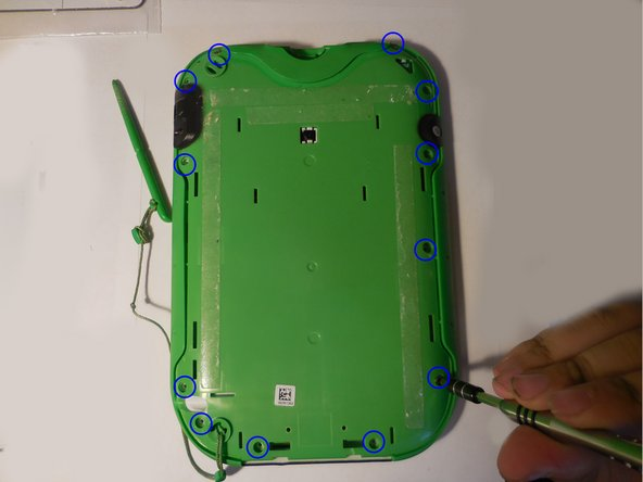Remove the 7 mm screw to the right of the cartridge dock, two 8 mm screws in the top left, and the nine 8 mm screws holding the the green shell.