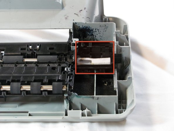 Remove the printer head cleaner by lifting the front of the printer head cleaner above the track and slide it forward.