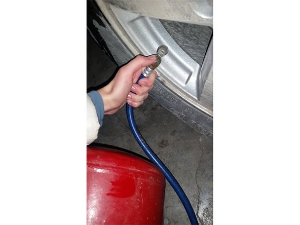 Using the air compressor, air the tire up to the original recommended weight for the vehicle.