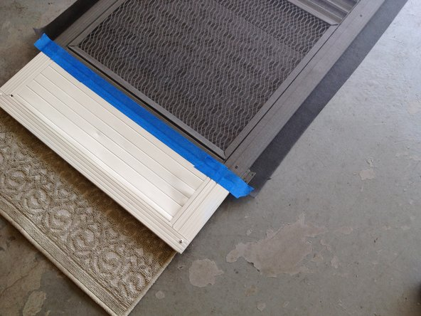 Place the screen door on a completely flat surface. Lay the new screen across the frame.