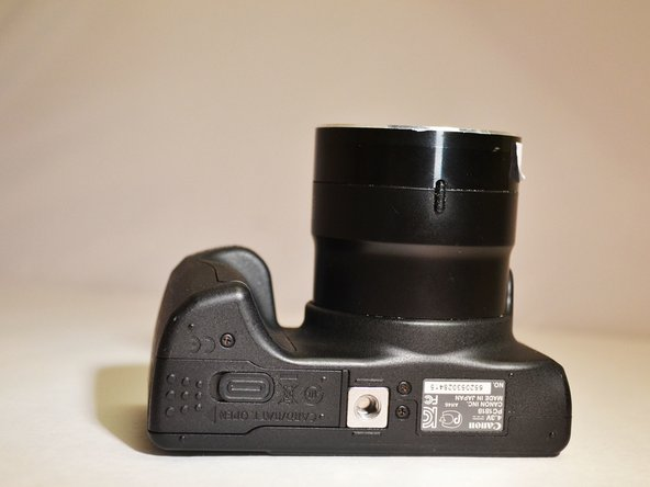 Rotate the camera to expose the underside of the camera.