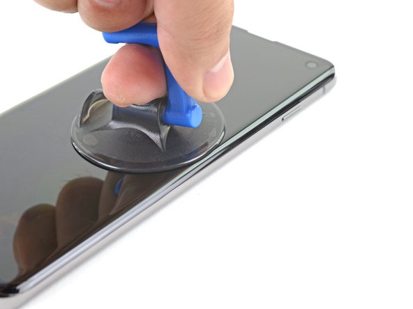 Apply a suction cup to the heated edge of the display.