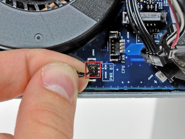 Pull the power button cable connector up off its socket on the logic board.