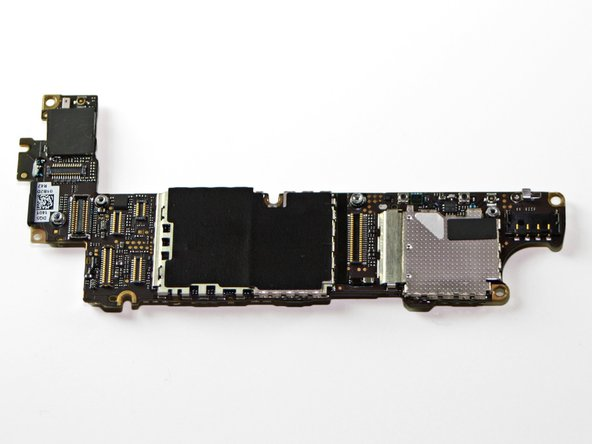 With the help of our iPhone opening tool, we pop out the logic board.