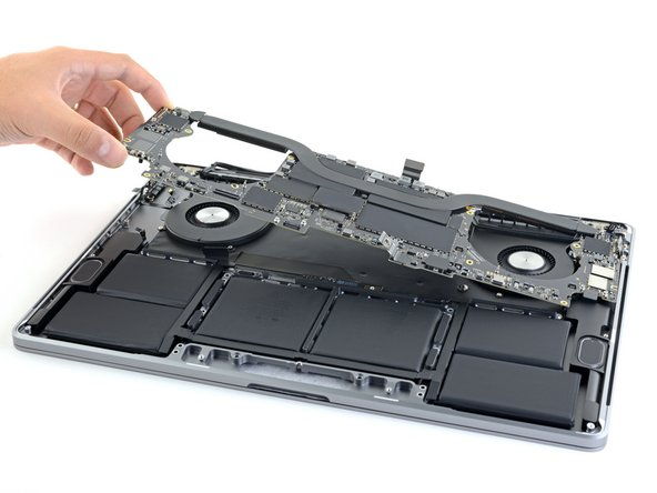 Lifting from the left side, remove the logic board.