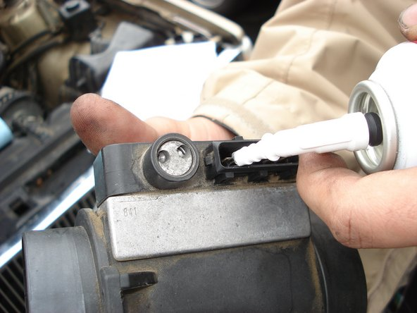 Inject conducting lubricant into  the MAF sensor electronic coupling.