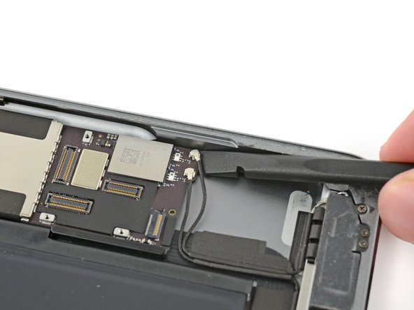 Insert a spudger under the right antenna cable closest to the edge of the iPad and lift upward to disconnect the antenna cable connector.