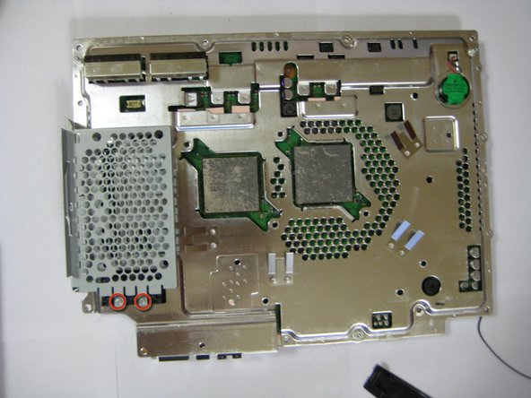 Remove the 2 Phillips #0 screws from the hard drive enclosure.