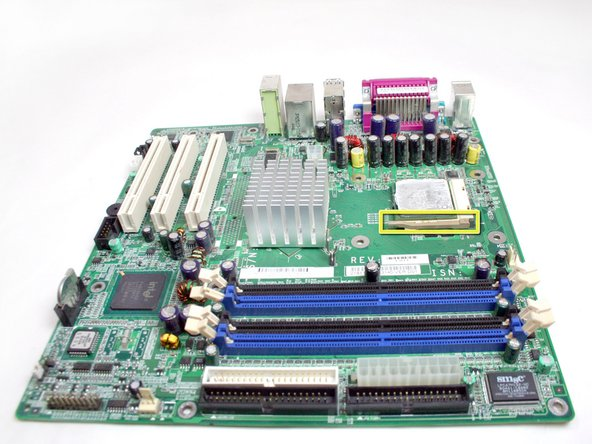 Lift up the bar that secures the processor to the motherboard